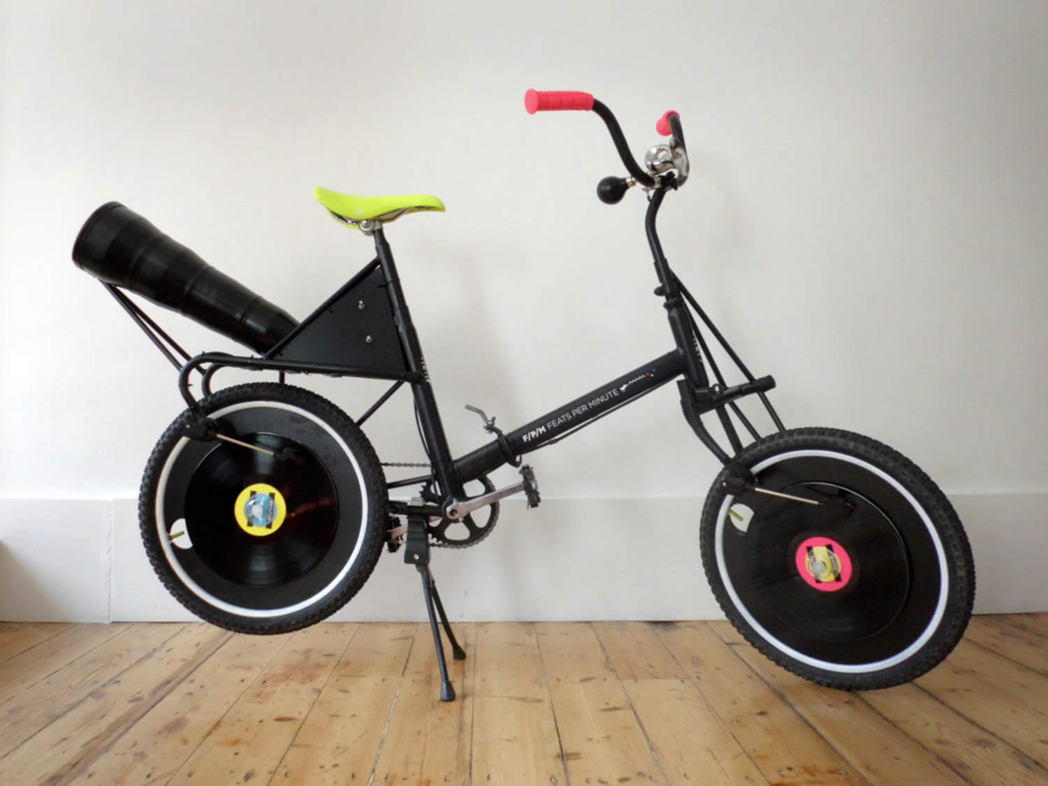 side view, feats per minute, bmx with vinyl records