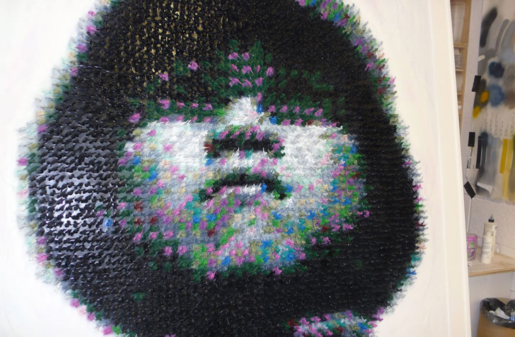 5,500 Plastic Toys form the Face of a Chinese Soldier