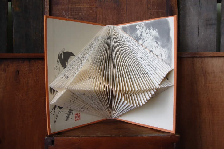 Triangular book sculpture by Paper folding art from Exploded Library