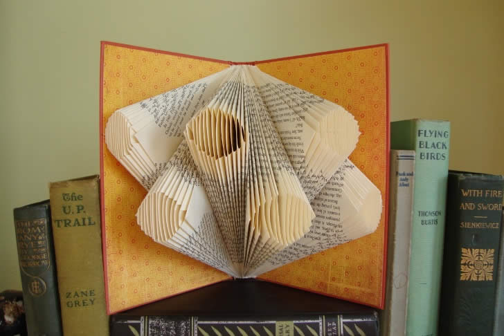 Circle tube book art by  Exploded Library