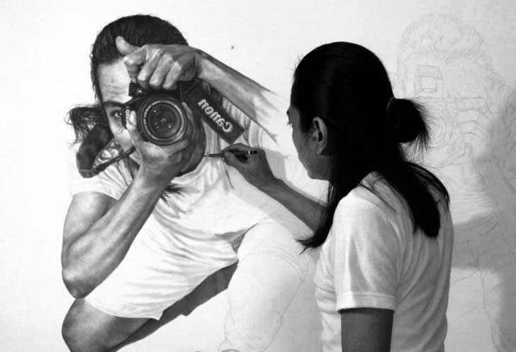 Man holding a Camera. Drawing by Veri Apriyatno