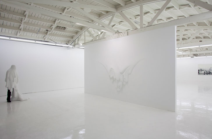 Daniel Arsham's melting figure and wall