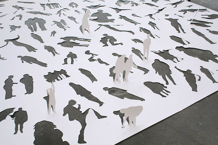Human figures cut out from paper by Peter Callesen