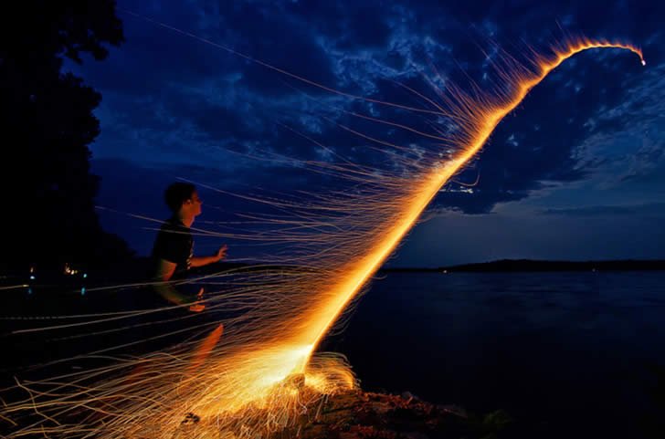 Fireworks in with kid by Dan Anderson