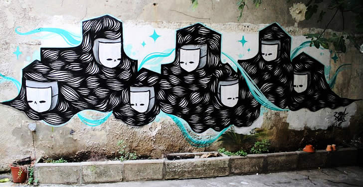 Two characters in black and turquoise. Graffit by GoddoG