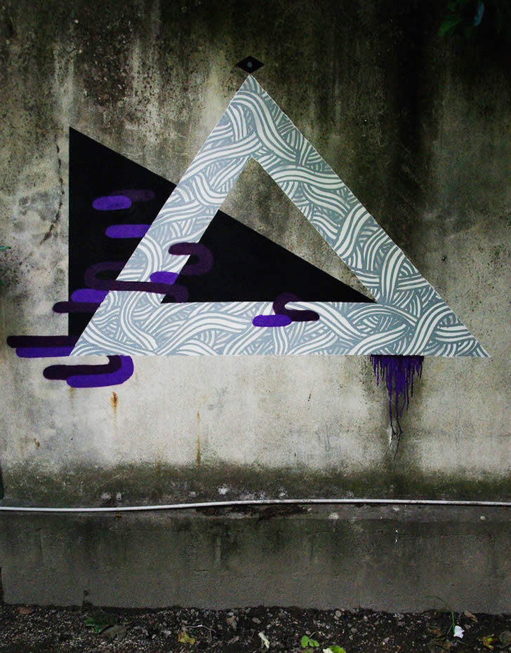 Triangle pattern graffiti by Two characters in black and turquoise. Graffit by GoddoG