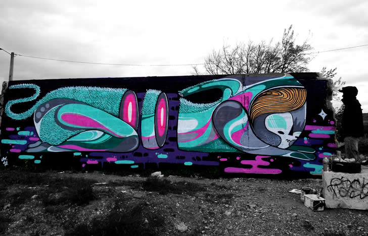 Rabbit graffiti by Two characters in black and turquoise. Graffit by GoddoG