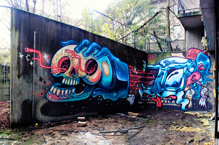 Hand holding skull. Graffiti by Nychos