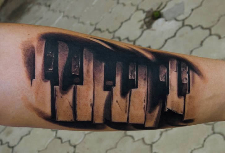 Piano tattoo by AD Pancho