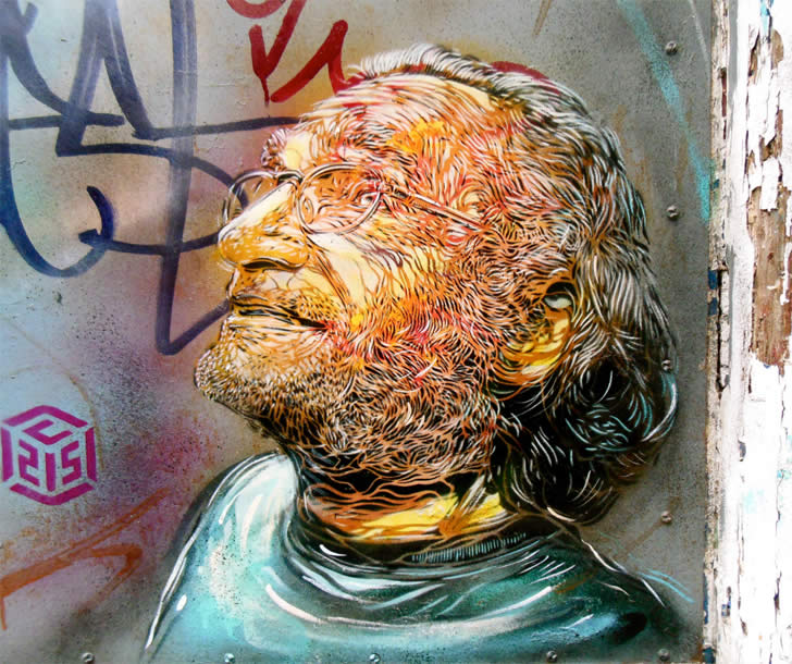 Expressive man's face, graffiti by C215
