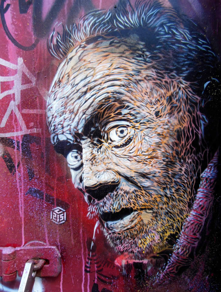 Homeless man graffiti by C215