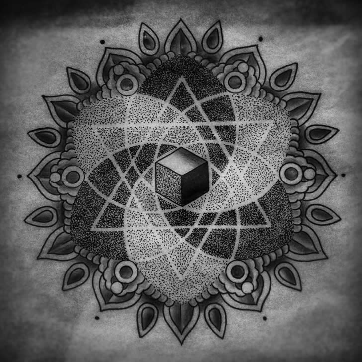 Spritual tatto with triangle and cube by Michael Bennett