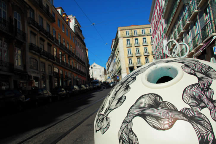 Drawings on Recycle bin in Lisbon by Vitor Santos