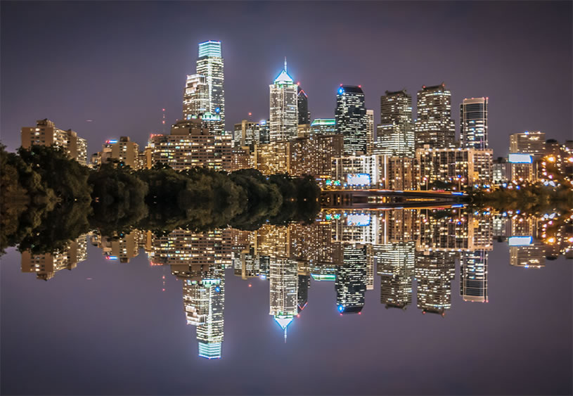Cityscape reflection on the Schuylkill River by Bill Dickinson
