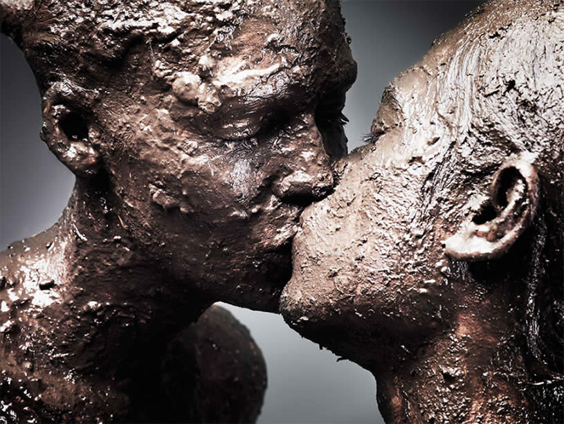 Mud on a Couple Kissing byHuman Wave by Henrik Sorensen