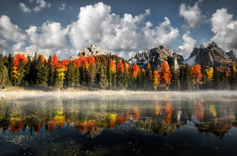 Misurina Antorno lake, Dolomiti. Rainbow Trees reflection by Marco Carmassi
