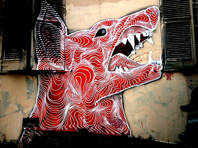 Raging red dog mural by Awer