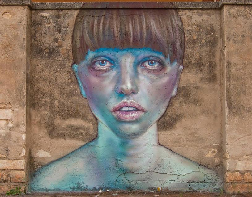 Blue Faced Woman on Wall. By Caktus&Maria