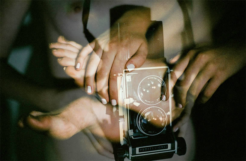 Hand and feet with camera, by Nathan Bobey