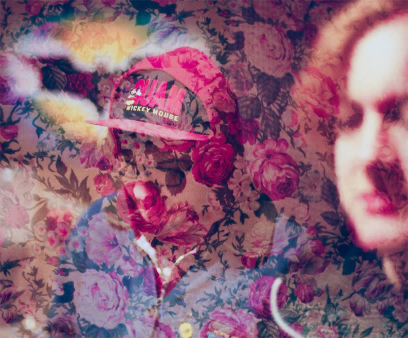 Cap guy with roses by Nathan Bobey