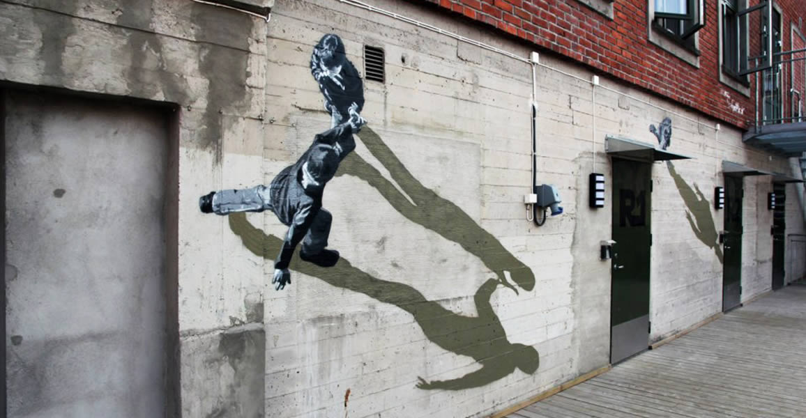 People on wall with shadow. Street art by Strok