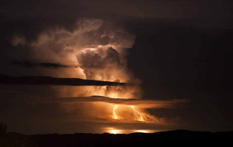 Orange sky with lightening by Willoughby Owen