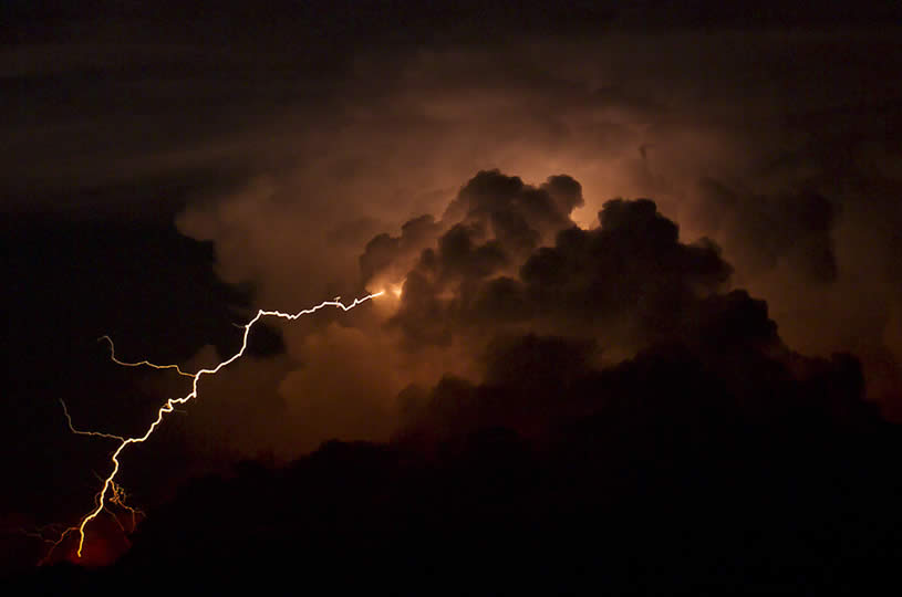 Dark sky with lightening by Willoughby Owen