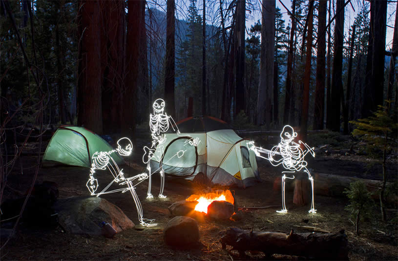 Skeletons camping, light painting by Darius Twin
