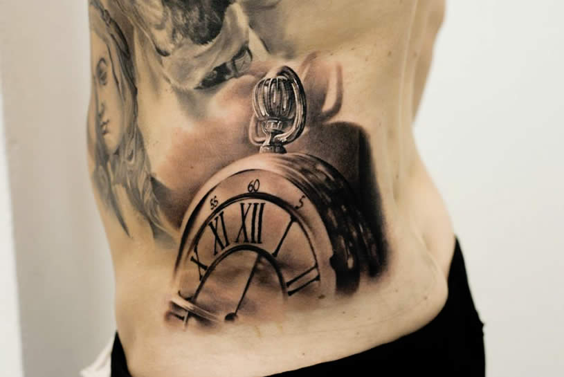 Old pocket watch tattoo on arm by Denis Sivak
