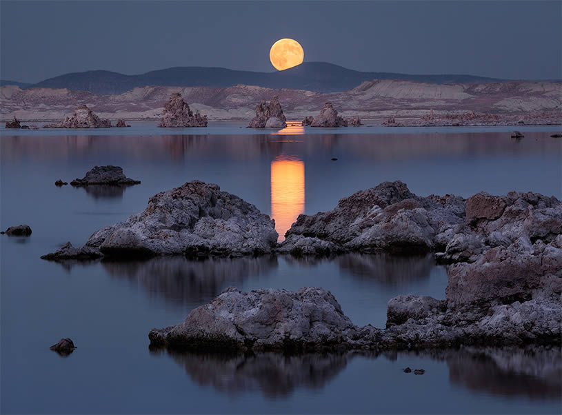 Moon over water. Blue scene by Pacheco