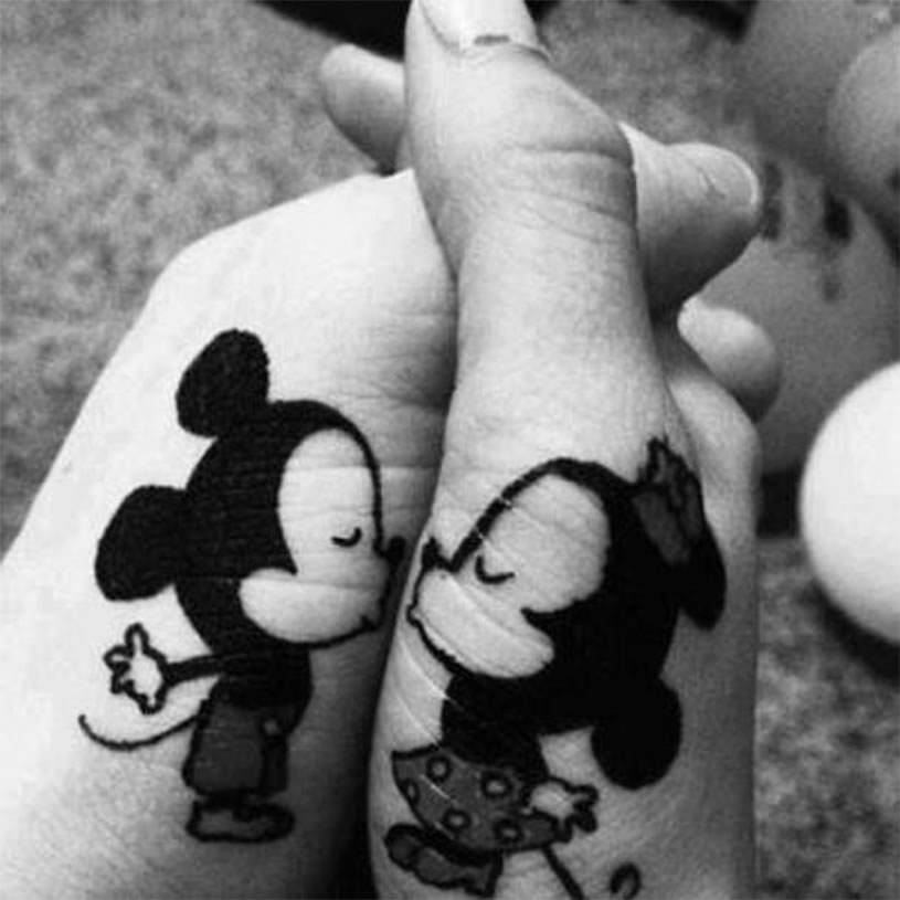 Mickey and minny tattoos on hands