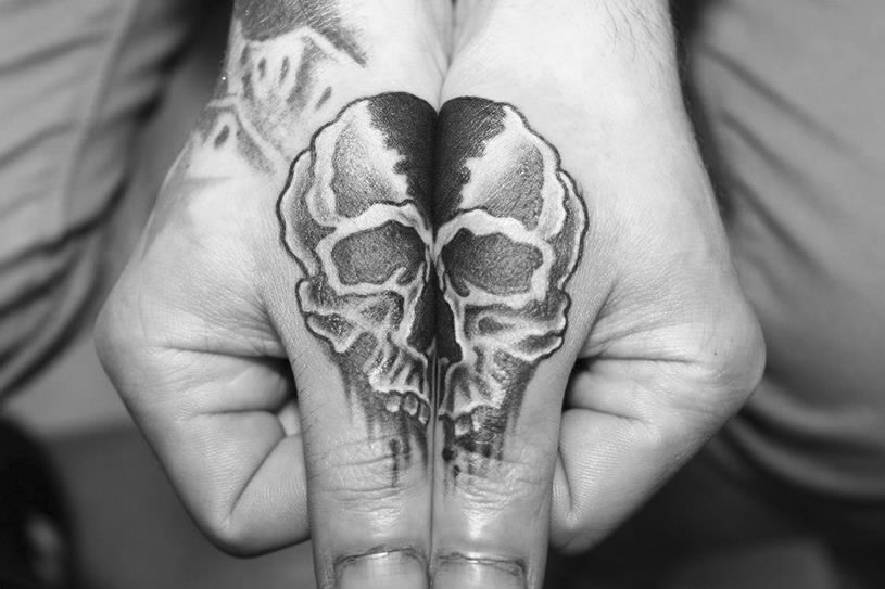 skull tattoo connection on hands