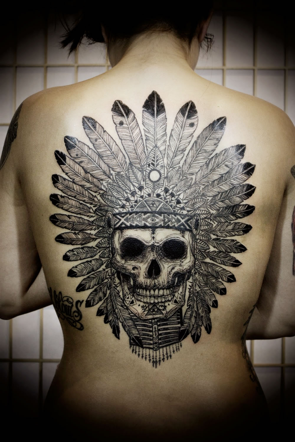 Skull Indian tattoo on back by David Hale