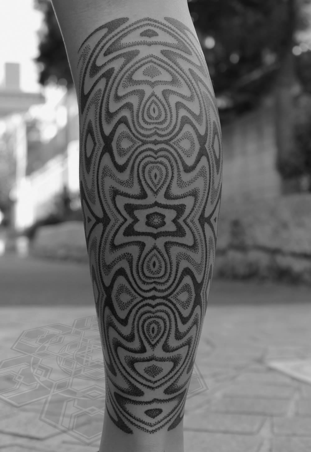 Psychedelic tattoo by Kenji Alucky