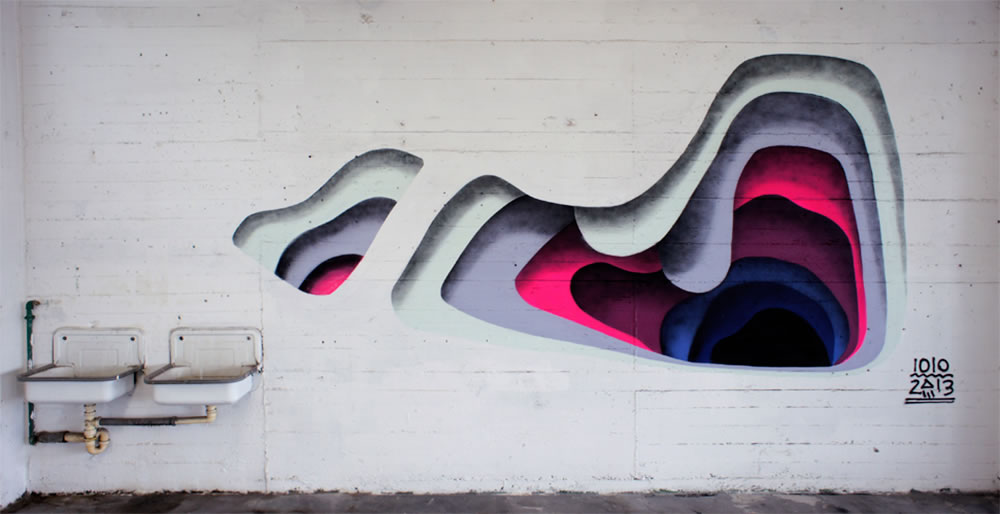 layer cutouts on wall, graffiti by 1010