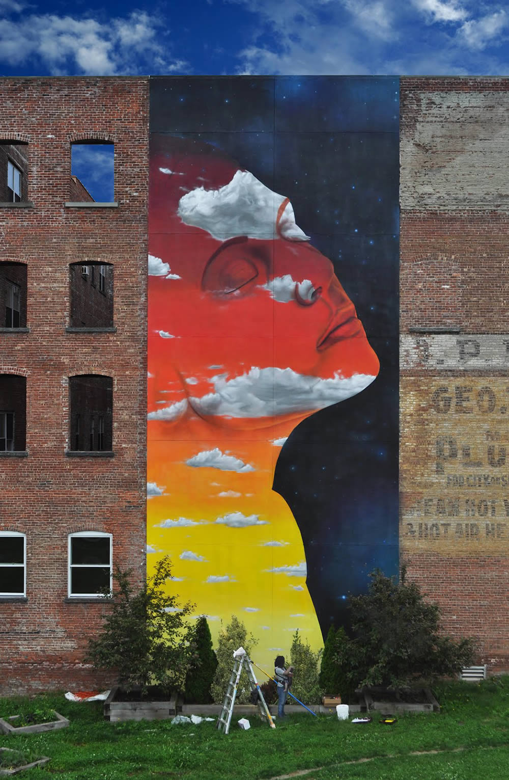 Rainbow face with clouds, mural by dasic