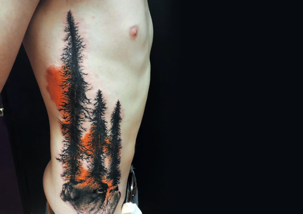 trees and red sky tattoo by toko loren