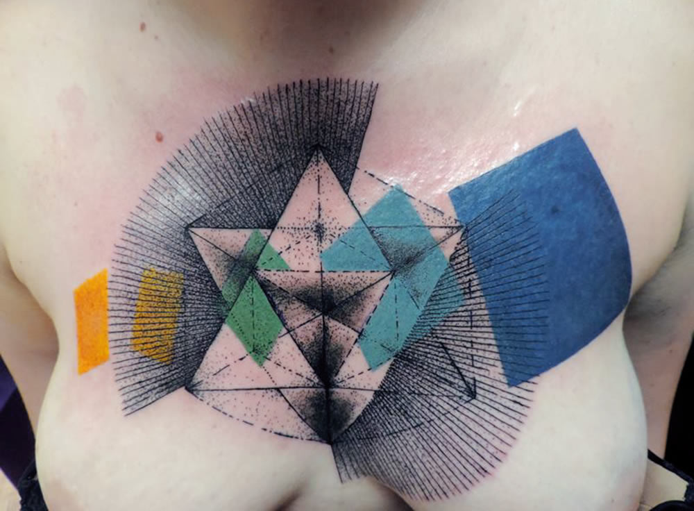 blue, turquoise, green yellow shapes tattoo by toko loren