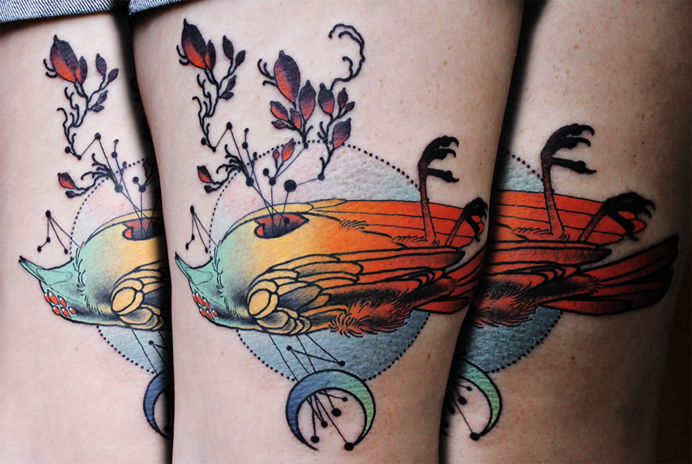 Bird tattoo with rainbow colors by cody eich