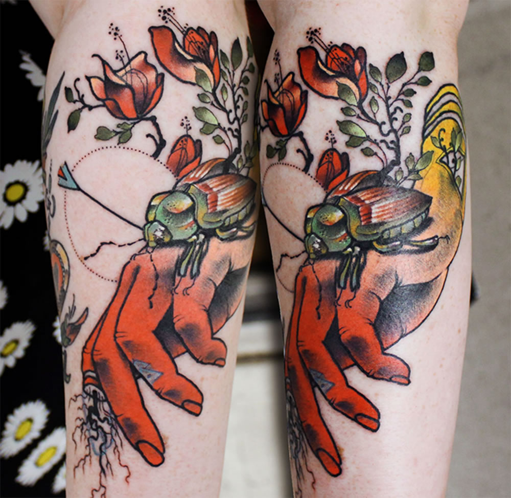 red hand with red roses tattoo by cody eich
