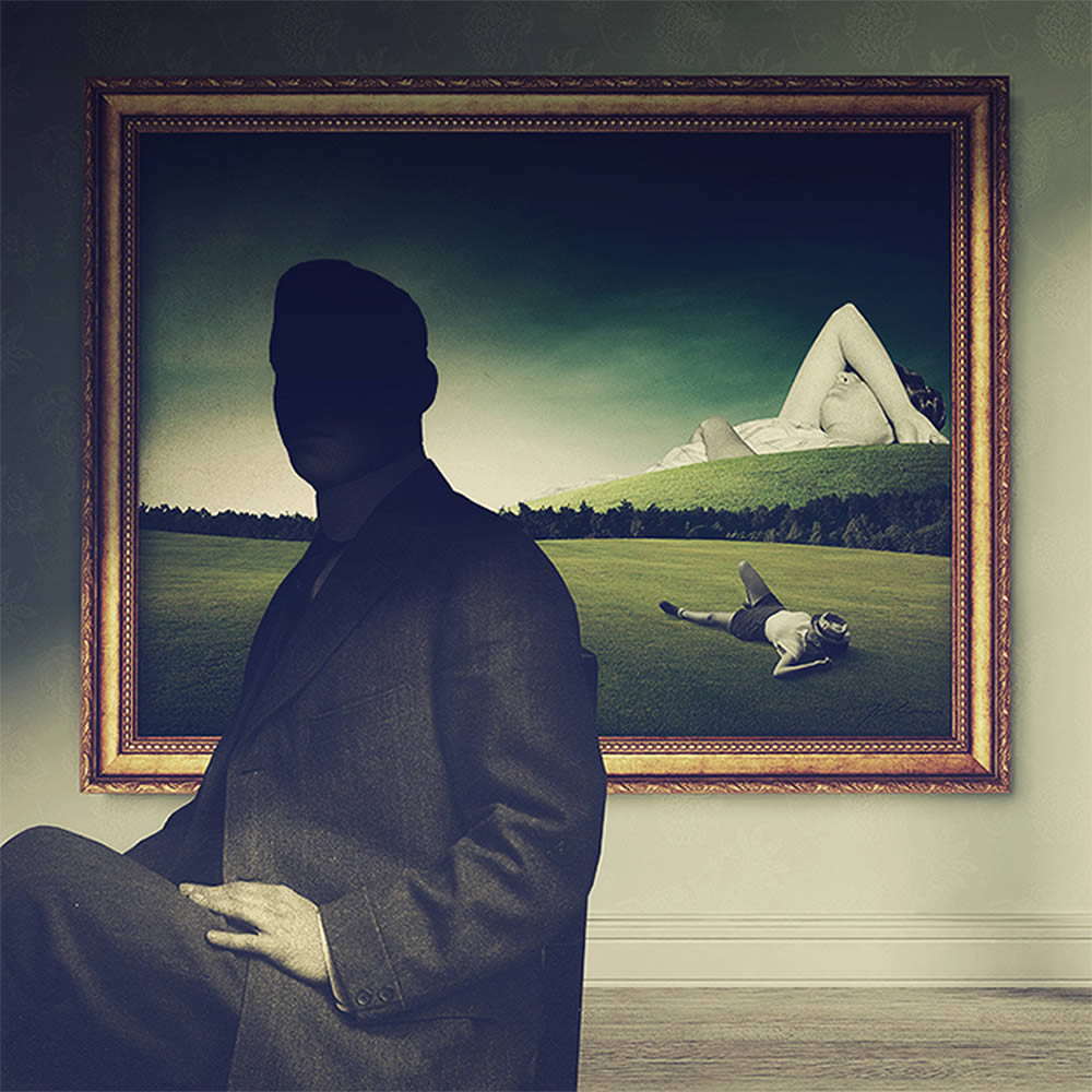 silhouette of man with framed portrait behind by joseba elorza