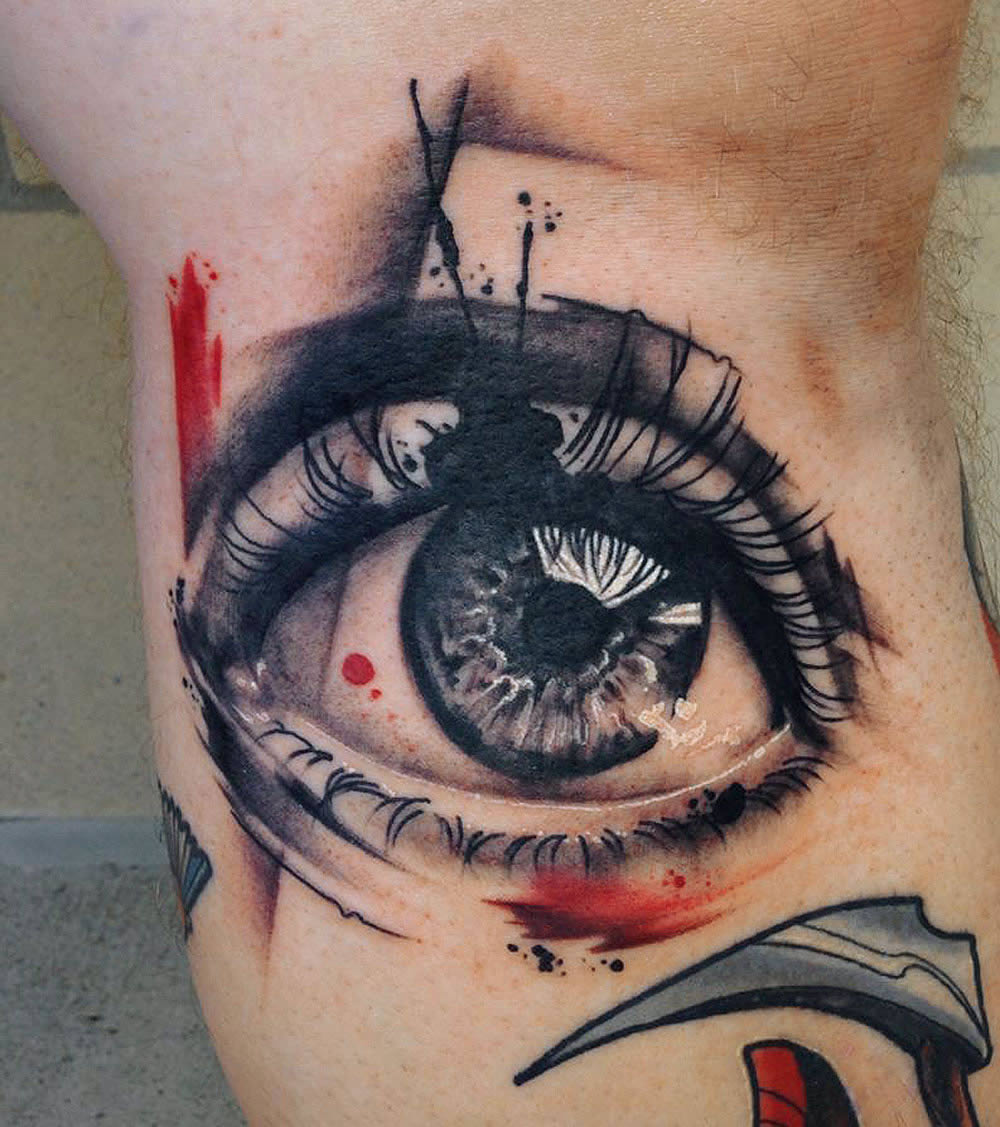 black and red eye tattoo by mike shultz