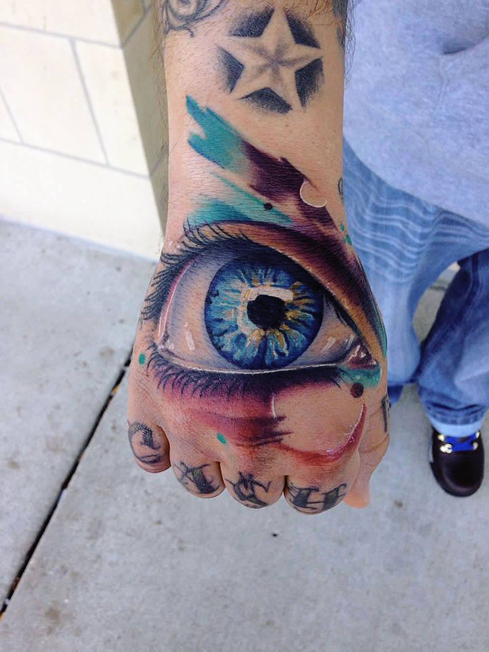 blue eye tattoo by mike schultz