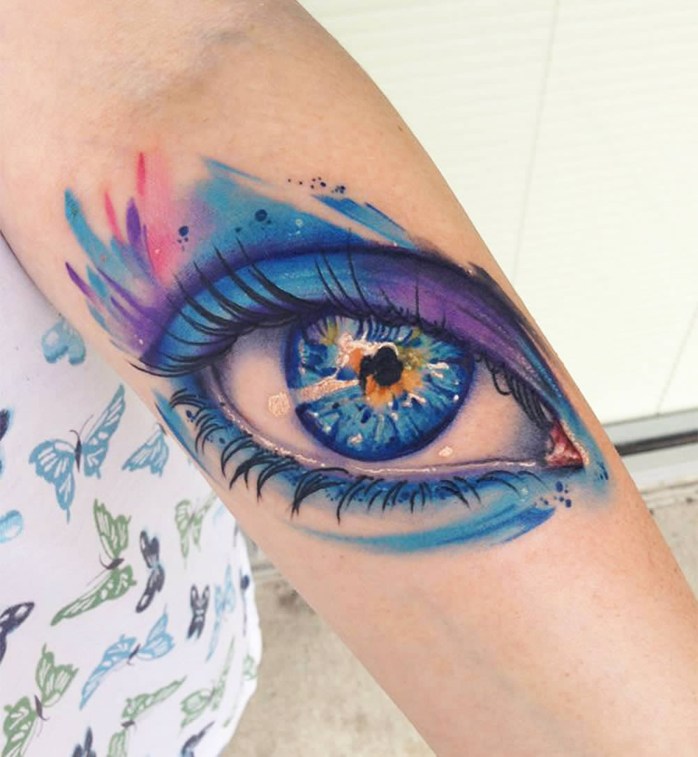 colorful rainbow eye tattoo by mike schultz
