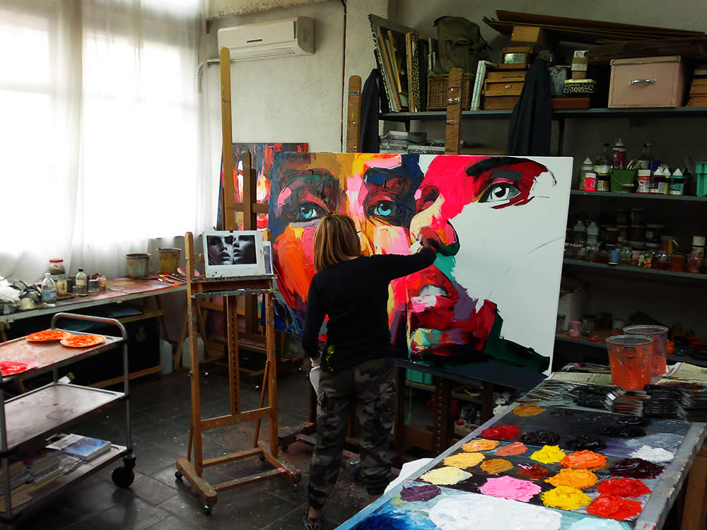 Francoise Nielly painting in her studio.
