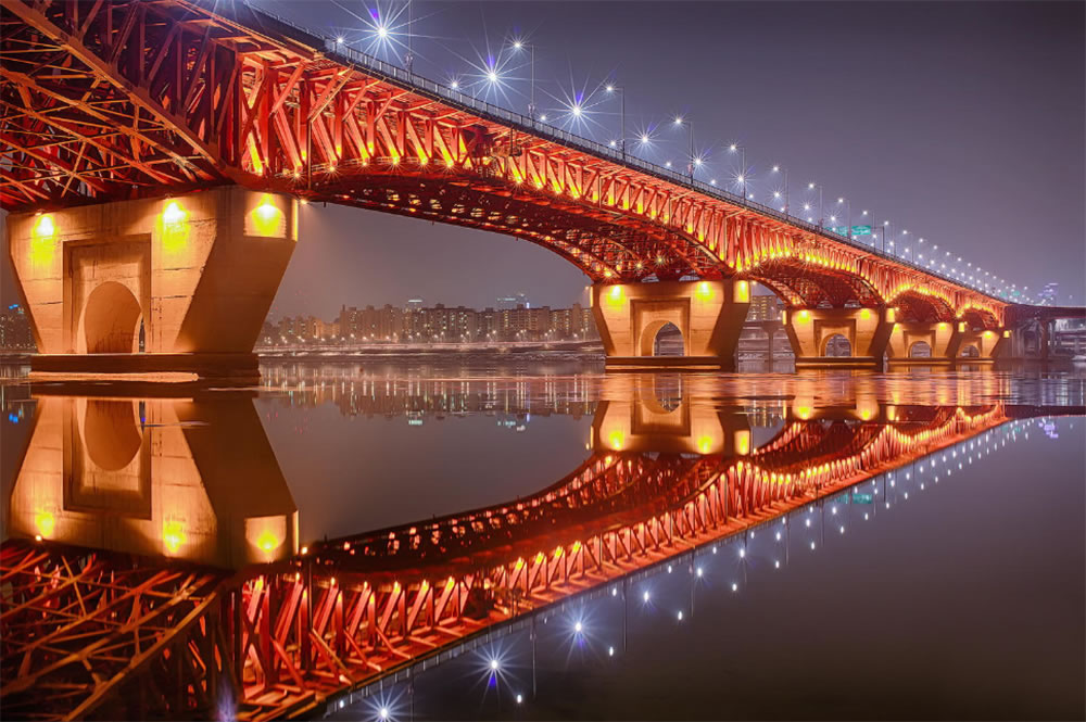 Night time, brige light reflection by Gyun Woo