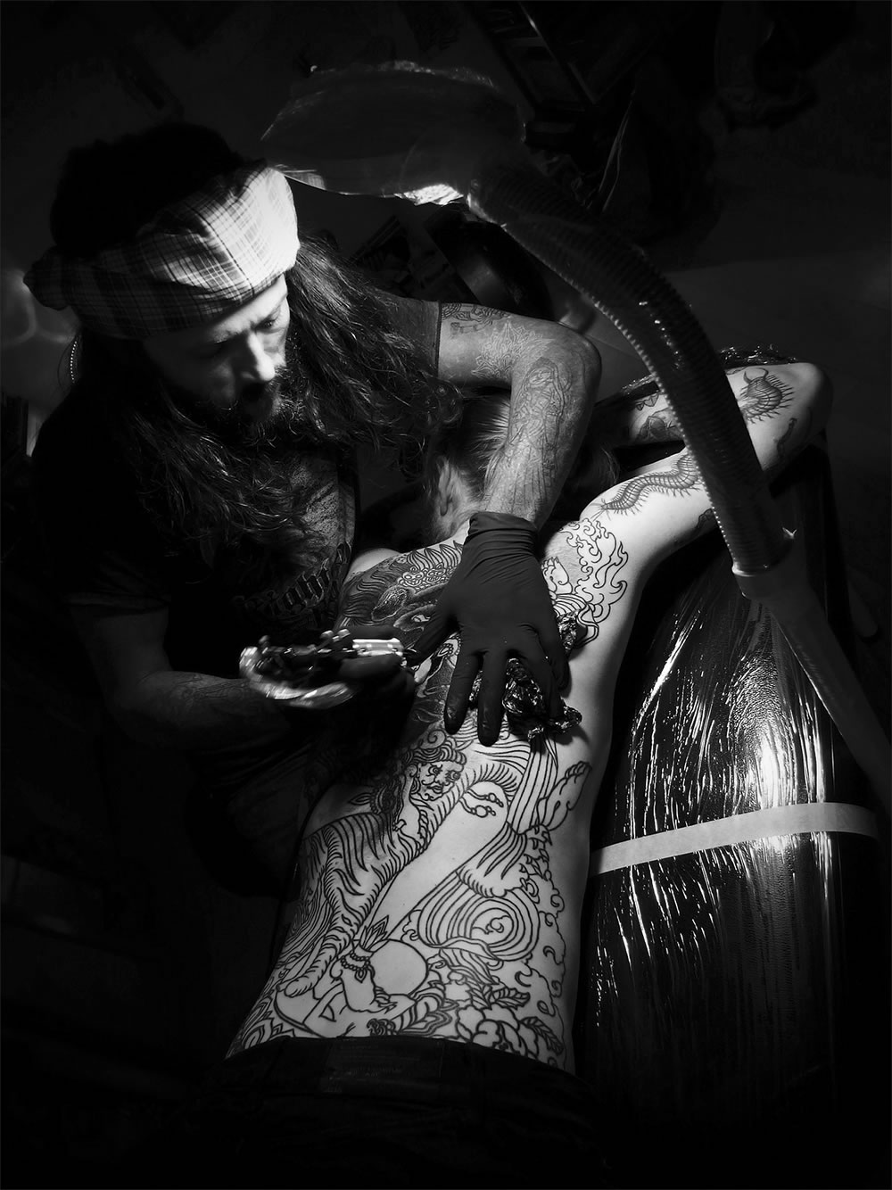 Guy Le Tatooer working on a back piece