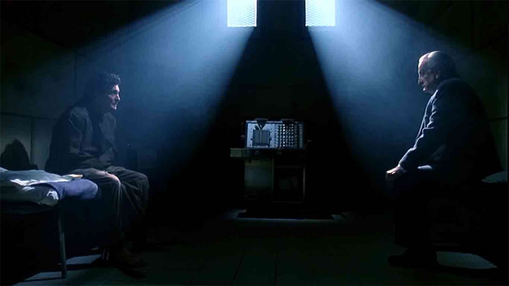 Father Karras talking to his old buddy Lt. Kindermann in The Exorcist III. Only problem is, Karras is dead.