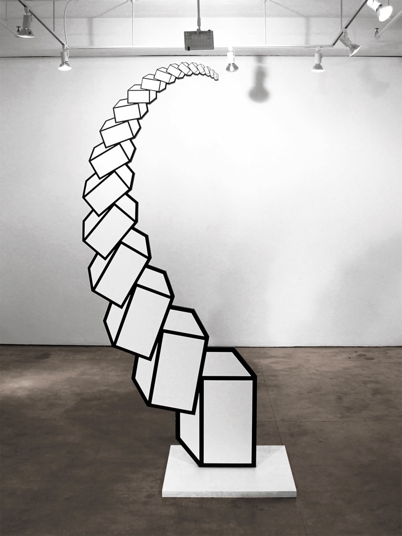 geometric 3d boxes piled up in gallery, by Aakash Nihalani