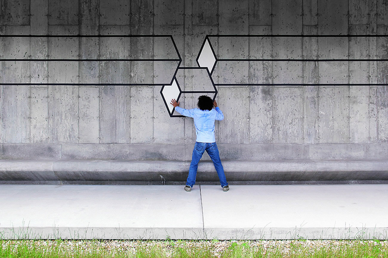 cube fits into rectangles on wall, by Aakash Nihalani